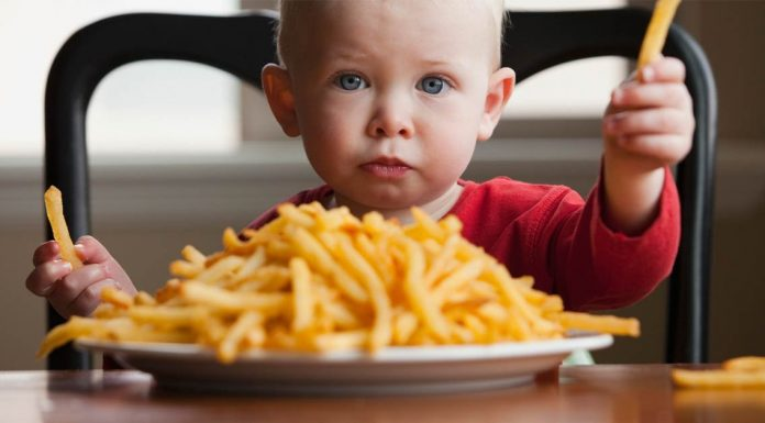 Child eats French Fries