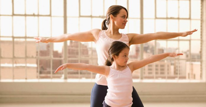 Women workout with kid